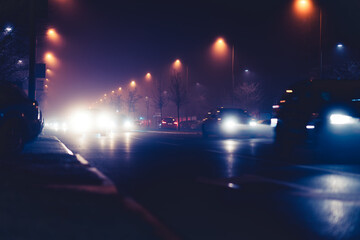Traffic in the city with car lights and street lighting at night