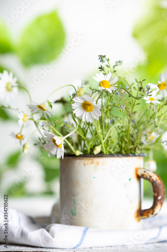 Fototapety, obrazy: Wildflowers in an old metal mug. Summer concept.