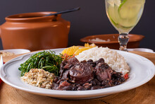 Typical Brazilian Dish Called Feijoada. Made With Black Beans, Pork And Sausage