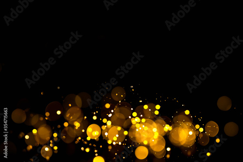 Golden abstract bokeh on black background. Holiday concept Fototapet