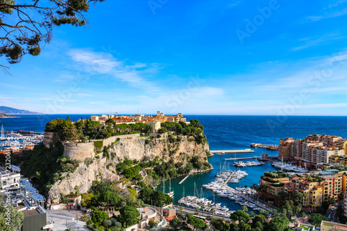 View of the Rock of Monaco (French: Le Rocher) and parts of Monte Carlo and Fontvielle harbors at the Mediterranean waterfront. Monaco-Ville, Monaco.