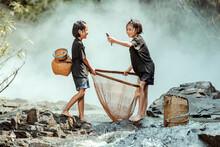 Two Girls Fishing In The Strea...