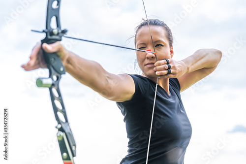 attractive sports woman in archery, arrows and bow in action Tapéta, Fotótapéta