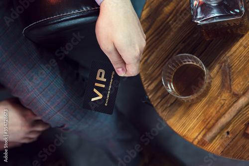 Fotografía Man holds VIP member card in his hand