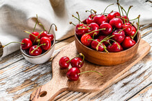 Red Cherries In A Wooden Bowl....