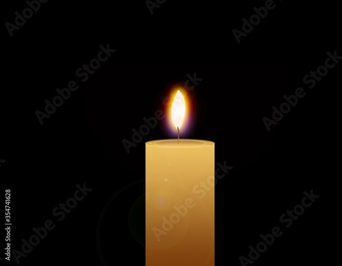 Flaming candle isolated on a black background