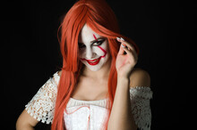 A Girl In A Clown Costume With...