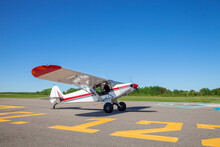 Pilot In Small Plane Taxis Tow...