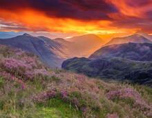 Sunrise Fire Sky Over The Mountains Of Glencoe, Highlands, Scotland, Uk.