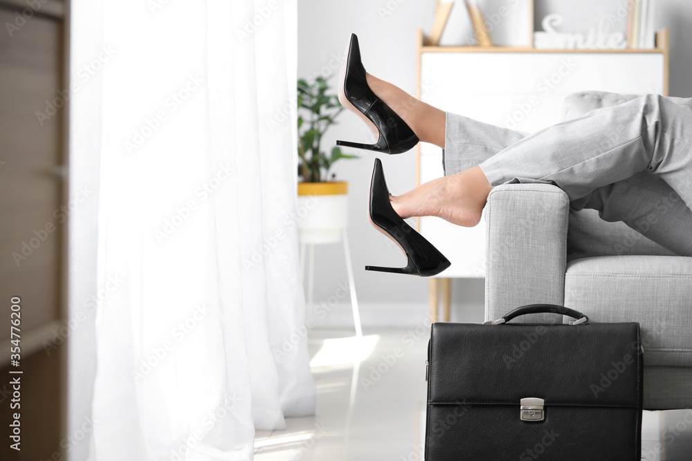Fototapeta Businesswoman relaxing on sofa after work at home