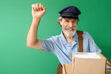 Handsome Old Postman On Color Background