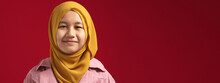 Portrait Of Young Happy Confident Muslim Teenage Girl Wearing Hijab Looking At Camera And Smiling Cheerfully