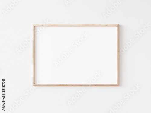 Landscape thin wooden frame on white wall. Horizontal wooden frame. 3d illustration.