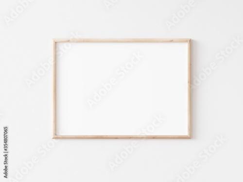 Fototapeta Landscape thin wooden frame on white wall. Horizontal wooden frame. 3d illustration. obraz