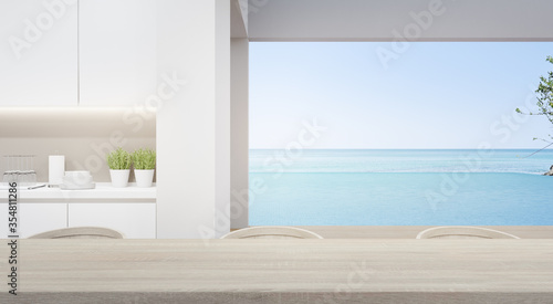 Leinwand Poster Dining room near modern kitchen in luxury beach house