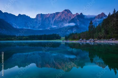 Fototapeta Spectacular, beautiful sunrise over the alpine Lake Laghi di Fusine in the Julian Alps in Italy obraz
