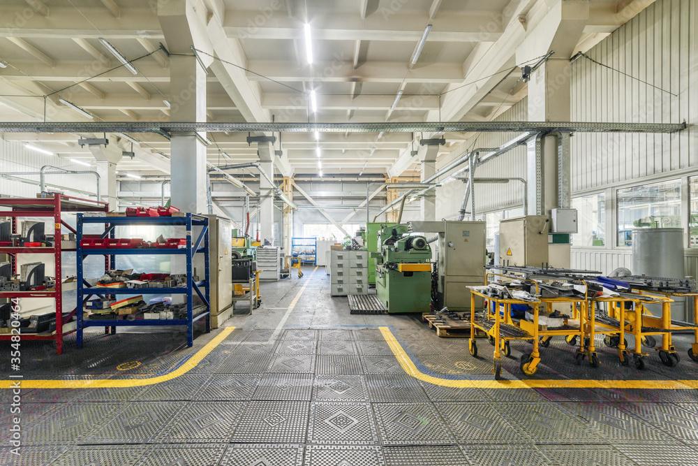 Fototapeta The interior of the metalworking shop. Modern industrial enterprise.