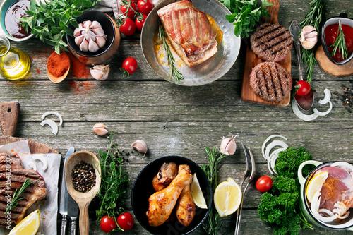 Fototapeta Grilled meat  on rustic wooden table obraz na płótnie