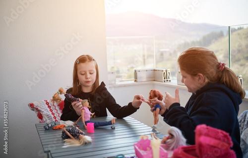 Obraz na plátne little girls playing with dolls