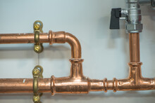 Copper Pipework With Isolator Valve. Close Up View.