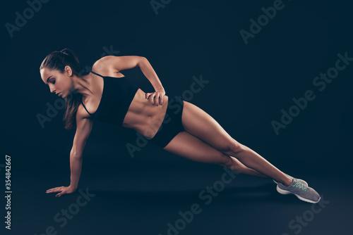 Fotografía Full length photo almost naked short sport suit lady doing side plank determinat