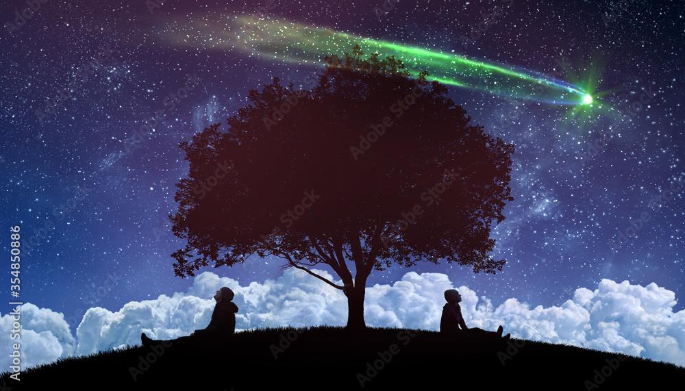 Fototapeta couple outdoors watching the stars in night sky