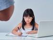Little girl doing online class.