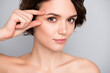 Leinwandbild Motiv Close up photo of charming pretty gorgeous girl touch finger eyes look in mirror plastic surgery for soft ideal perfect skin effect she tried isolated over gray color background