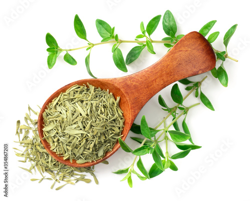 dried thyme leaves in the wooden spoon, with fresh thyme isolated on white backg Billede på lærred