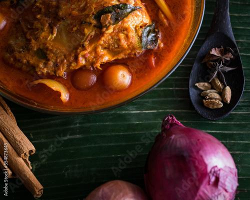 Fototapeta Cooking spices on banana leaf