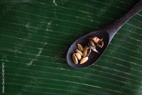 Fotografie, Obraz Cooking spices on banana leaf