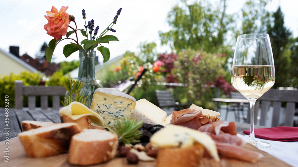 Fototapeta Antipasto on garden terrace