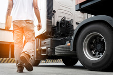 Truck Transportation, A Truck Driver Walking Around Semi Truck Inspecting And Safety Check Before Driving A Truck