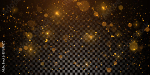 Foto Sparkling golden particles, glowing bokeh lights isolated on dark transparent ba