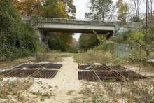Bridge Over Disused Train Tracks Covered In Brush