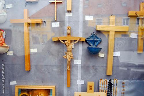 Tela Christian crosses, crucifixes, behind shopping window