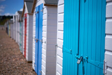 White Wooden Beach Huts With C...