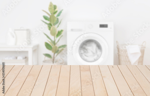 Wooden planks table template in laundry room for product display фототапет