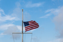 American Flag On Mast In Stiff...