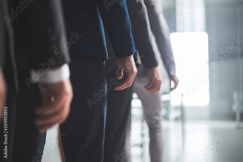 Fototapeta close up. group of employees leaving the office. obraz
