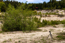 Small Camera On Tripod Photographing Former Limestone Quarry. Tourist Viewpoint. Nowiny Quarry Near Susiec, Poland, Europe.
