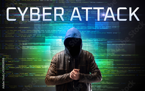 Fototapety, obrazy: Faceless hacker with CYBER ATTACK inscription on a binary code background