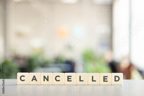 Photo white cubes with word cancelled on white surface