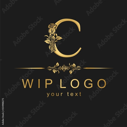 Foto Classic logo with a flower. Gold rose on the capital letter.