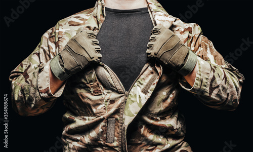Cuadros en Lienzo Soldier in camouflaged tunic, torso view with shirt.