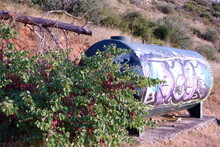 Colourful Tank With Graffiti And Water On The Mountain