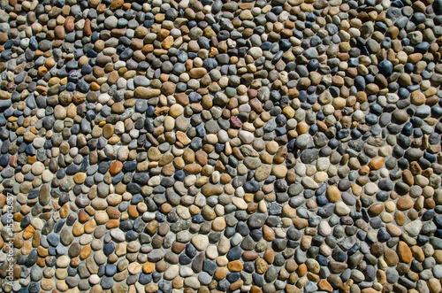 Pebble wall texture. Stone wall made of pebbles