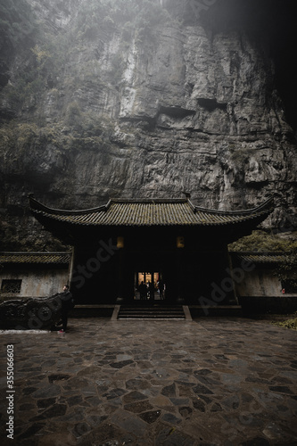 Temple by cliff, Wulong Karst, China - 355066603