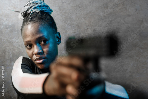 Cuadros en Lienzo Hollywood movie style portrait of young attractive and confident black African A