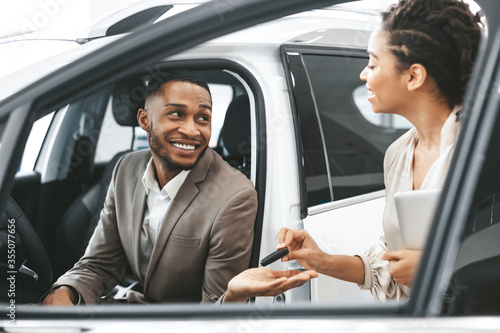 Businessman Taking Key From Dealer For Test Drive In Dealership Fototapet